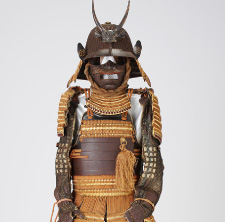 Armor with a russet-iron-lacquer-finished, two-piece set of cuirass of horizontally arranged and riveted plates(or okegawa-do), provided with red lacings at the top and bottom areas of the cuirass.